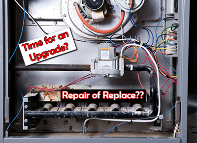 Furnace repair, HVAC replacement, close up of inside of a furnace that needs servicing